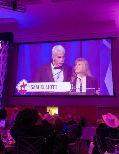 MCs Sam Elliott and Katharine Ross on the big screen.